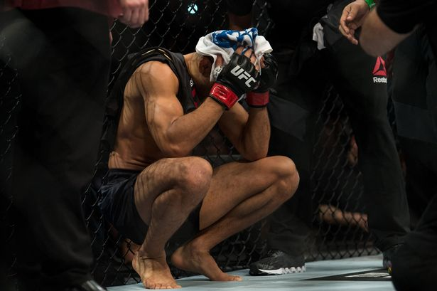 Jose-Aldo-reacts-to-his-knockout-loss-to-Conor-McGregor-in-their-featherweight-championship-fight